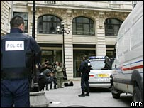 Journalists and police wait outside the Paris court financial crimes section