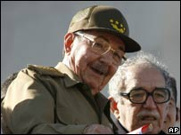 Cuba's Acting President Raul Castro (L) chats with Colombian writer Gabriel Garcia Marquez during a military parade along the Revolution Square in Havana.