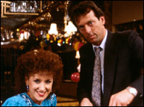 Den Watts (Leslie Grantham) and Angie (Anita Dobson)