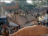 Crowds gather at train accident site in Bhagalpur, India