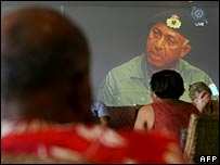 Fijians and tourists watch Cmdr Bainimarama on TV