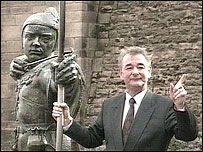 Brian Clough with the Robin Hood statue in Nottingham
