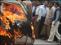 A car that defied the strike is set on fire in Dhaka