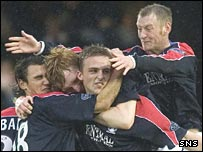 Marc Twaddle is swamped by team-mates after opening the scoring