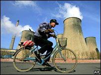 Cyclist passing power station. Image: AP