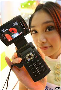Model shows off a mobile phone