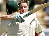 Clarke shares a hug with Shane Warne