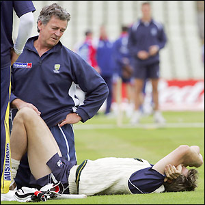 McGrath lies in pain after treading on a loose ball in training