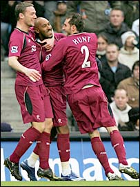 Nicolas Anelka (centre) celebrates his opener