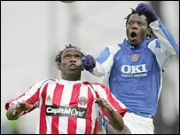 Sheff Utd's Claude Davis and Benjani of Portsmouth