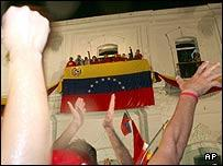 Newly re-elected Venezuelan President Hugo Chavez greets supporters in Caracas
