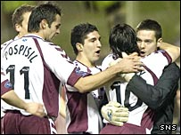 Paul Hartley celebrates with missing captain Craig Gordon