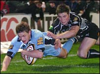 Cardiff Blues full-back Ben Blair scores his second try against the Ospreys