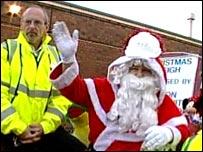 Santa on his sleigh with a bodyguard