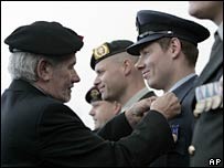 Dutch soldiers receive a decoration at a military base in Assen
