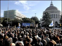 Hundreds gather in a Rome square, Sunday, Dec. 24, 2006 for the lay funeral of a paralyzed Italian man