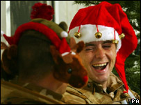 Soldiers with festive headgear