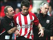 Prutton is led away by Southampton's coaching staff