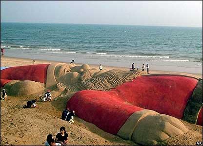 Sand sculpture of Santa on a beach in Puri.