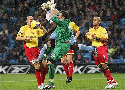 Manchester City's Micah Richards clashes with Watford keeper Richard Lee