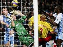 Watford keeper Richard Lee makes a save at Manchester City