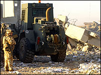 UK troops survey police station rubble