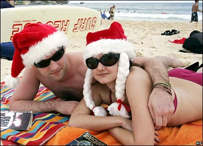 Michelle Higgins of Ireland and compatriot Owen Brick lie in the sun at Sydney's Bondi Beach on Christmas Day.