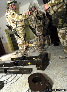 British soldiers prepare to blow up Jamiat police station