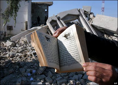 A copy of the Koran with a bullet hole