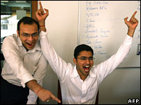 Indian stockbrokers react while trading shares at a brokerage house in Mumbai, 30 October 2006.