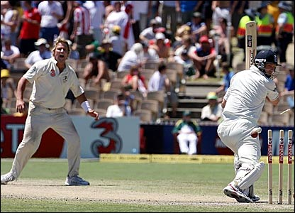 Sahen Warne (left) looks on as Matthew Hoggard drags the ball onto his stumps