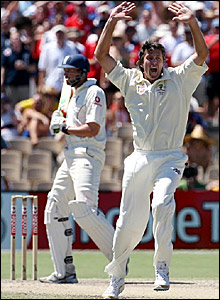 Glenn McGrath (right) successfully appeals for a leg before decision against Steve Harmison