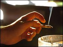 Man smoking cigarette in pub