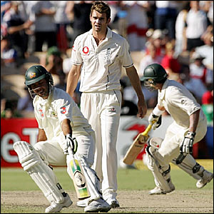 Ricky Ponting (left) and Mike Hussey (right) pile on the runs as James Anderson looks on
