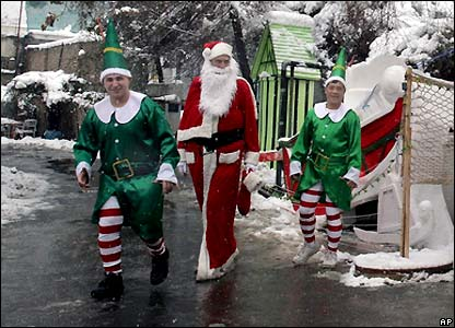 US soldiers at base in Kabul dressed as Santa Claus and elves