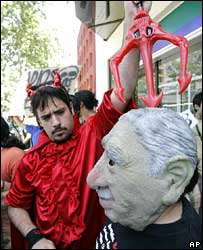 Opponents of Gen Pinochet protest outside the hospital where he is being treated