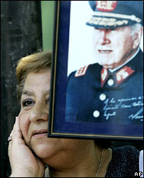A supporter of Gen Pinochet outside the hospital where he is being treated