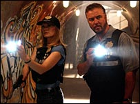 Marg Helgenberger and William Petersen in CSI: Crime Scene Investigation