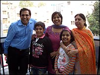Mahesh with his wife and children and a grandmother