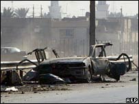 The wreckage of a car bomb at the site where the 15 employees of a Shia group were killed