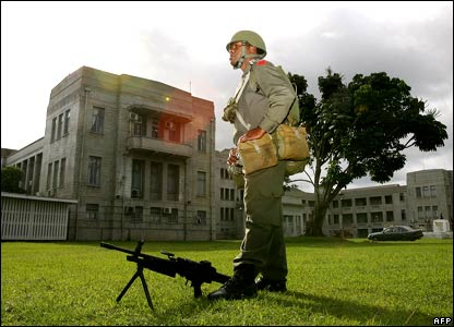 A soldier stands guard outside government buildings before Fiji's military head announced it had toppled the government.