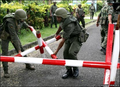 Fijian soldiers erect roadblocks around the home of Fijian Prime Minister Laisenia Qarase.