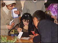Mohira Asadova signs autographs