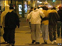 Young people wearing &quot;hoodies&quot; on a night out