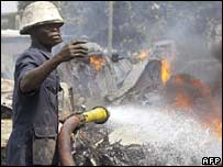 Firefighter tackling the blaze in Lagos, Nigeria