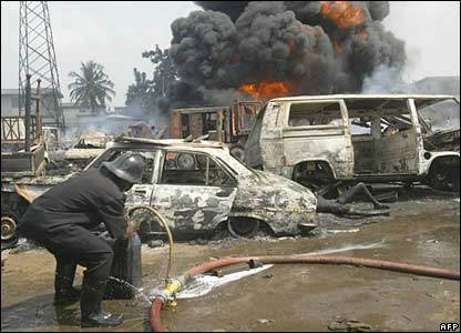 Burnt-out cars near the scene of the explosion