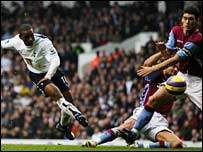Jermain Defoe of Spurs and Olof Mellberg and Gareth Barry of Aston Villa