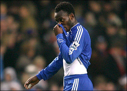 Michael Essien trudges off the pitch after scoring an own goal