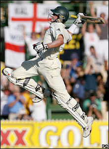 Australia's Michael Hussey celebrates hitting the winning runs against England during the fifth day of the second Test match at the Adelaide Oval, Adelaide, Australia