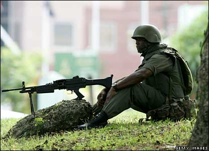 A soldier guards the area around government offices in Suva, Fiji